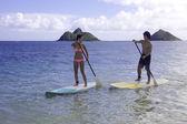 Japanese couple on paddle boards — Stock Photo