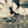 Stock Photo: Wedding gold rings of the groom and the bride on a table