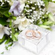 Wedding rings, gift box and flowers for bride. — Stock Photo #13621181