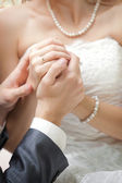 The groom holds the bride's hand — Stock Photo