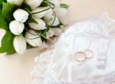 Wedding gold rings on a white pillow — Stock Photo