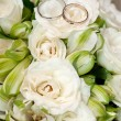 Gold wedding rings on flower — Stock Photo #13744319