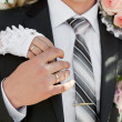 Hands of groom and bride with wedding rings — Stock Photo #15397935
