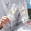 Wedding champagne in hands of bride and groom — Stock Photo