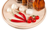 Mushrooms, peppers, tomatoes and spices on a cutting wooden board. Isolated. — Stock Photo