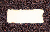 Sheet of old paper on the background of coffee beans — Stock Photo