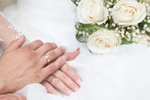 The groom embraces the bride — Stock Photo