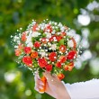 Beautiful bridal bouquet at wedding party — Stock Photo #33091235