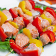 Shish kebab from fish on a stick — Stock Photo