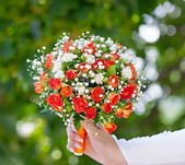 Beautiful bridal bouquet at a wedding party — Stock Photo