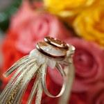 Gold wedding rings on flower . Decorating the wedding ceremony. — Stock Photo #33743521
