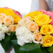 Wedding bouquet from fresh flowers in hands of the bride. — Stock Photo #33745223