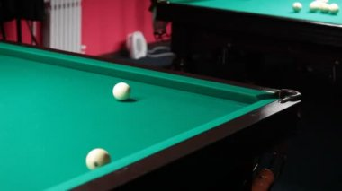 Sports game of billiards. Billiard ball rolls on the table.