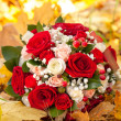 Wedding bunch of flowers lies on fallen leaves. — Stock Photo #36882251