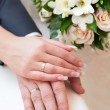 Hands of groom and bride with wedding rings — Stock Photo #36885709