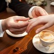 Groom wears wedding ring on bride's hand. — Stock Photo #36894235