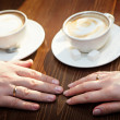 Hands of groom and bride with wedding rings — Stock Photo #36894321