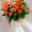 Wedding bunch of flowers in hands of bride — Stock Photo #36894487