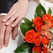 Wedding bunch of flowers in hands of the bride — Stock Photo