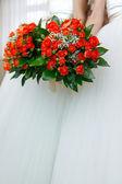 Wedding bunch of flowers in hands of the bride — Стоковое фото