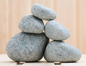 Sauna stones. Stacked on a wooden surface. Ready for heating. — Stock Photo