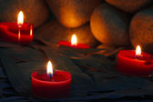 Candles are lit on the background of the sauna stones. Preparing — Stock Photo
