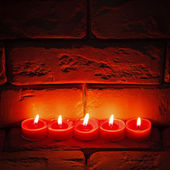 Burning candles are on the old stone surface. — Foto Stock