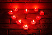 Valentines Burning candles in a heart shape standing on an old s — Foto Stock