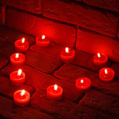 Valentines Burning candles in a heart shape standing on an old s — Stock Photo