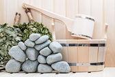 Broom, bucket, sauna stones and bath accessories. — Stock Photo