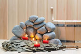 Candles, stones for sauna and bath accessories. — Stock Photo