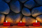Candles are lit on the background of the sauna stones. Preparing — Foto Stock