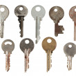 Set of old keys from door locks isolated on white background. — Stock Photo #42546127