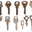 Set of old keys from door locks isolated on white background. — Stock Photo #42546299