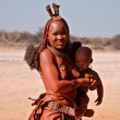 A woman from the African tribe with child — Stock Photo