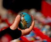 Hand holding a Christmas ball — Stock Photo