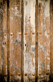 Wyblakły drewniane drzwi tekstura tło. — Zdjęcie stockowe