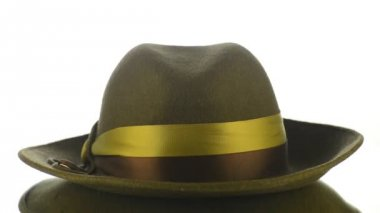 Green vintage hat on white background.