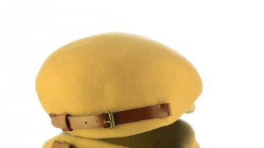 Yellow, retro style felt cap on white background.