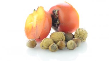 Ripe persimmon and nuts — Stock Video