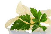 Potato chips and parsley — Stock Photo