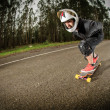 Downhill skateboarder in action — Stockfoto