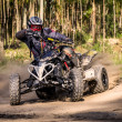 Постер, плакат: ATV racer takes a turn during a race