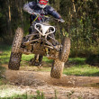 Stock Photo: Quad rider jumping