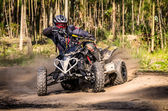 ATV racer takes a turn during a race. — Foto de Stock