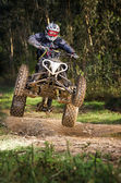 Quad rider jumping — Stockfoto