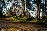 Quad rider jumping — Stock Photo