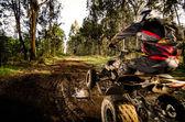Quad rider hoppning — Stockfoto
