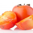 Persimmon with slice — Stock Photo