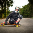 Downhill skateboarder in action — Stock Photo #25419675